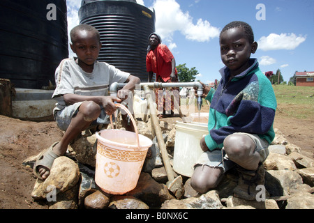 Kenyan refugees boys (internally displaced people = IDPs) at the refugee camp BURNT FOREST, Rift Valley - Stock Photo