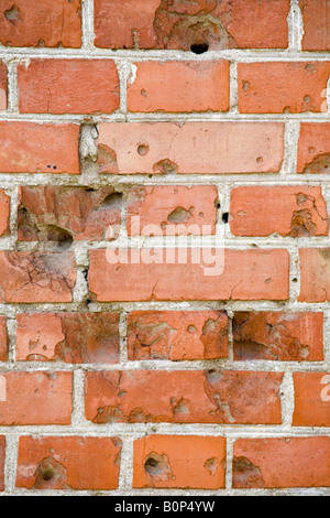 Bullet holes in a brick wall, Volgograd (formerly Stalingrad), Russia, Russian Federation - Stock Photo