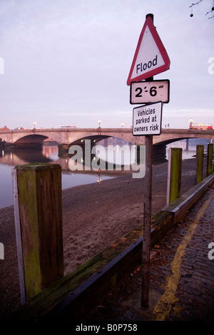 Sign to warn of flood hazard to drivers who may park cars by the river Thames at Putney. London UK. - Stock Photo