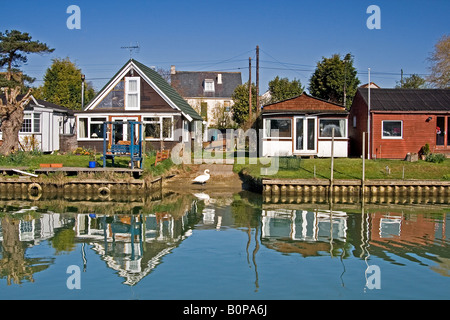 Houses reflecting on the Surfleet Resevoir in the Lincolnshire Fens - Stock Photo