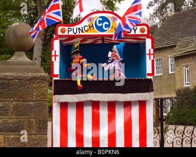 ... Traditional Punch and Judy Show with Judy hitting Mr Punch - Stock Photo & Red and White striped Punch and Judy booth ready for next show on ...