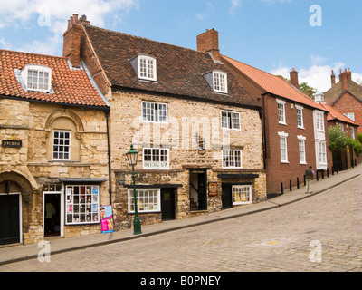 Jews Court on Steep Hill in Lincoln UK - an ancient medieval Jewish synagogue now a bookshop - Stock Photo