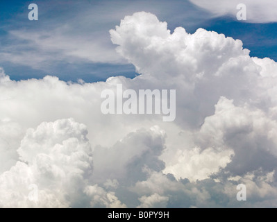 aerial above cumulus cumulonimbus cloud tops - Stock Photo