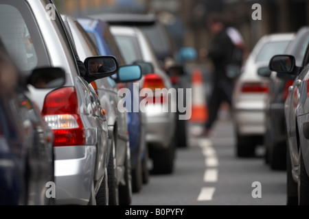 drivers sitting bored in their cars during traffic jam gridlock in belfast city centre - Stock Photo