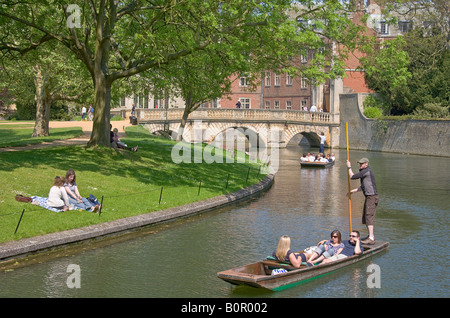 River Cam on a sunny day with punts, St Johns old bridge in background - Stock Photo