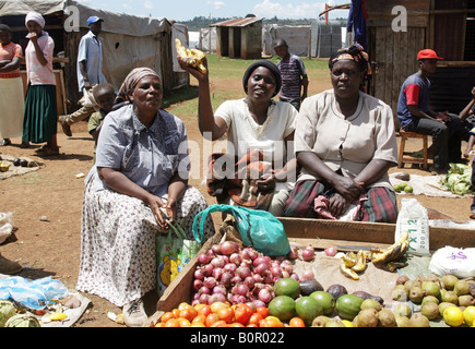 Kenyan refugees at their vegetables stand in the refugee camp BURNT FOREST, Rift Valley - Stock Photo