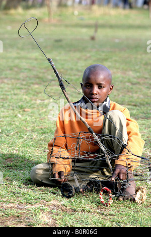 Kenyan refugee boy with his toy - Stock Photo