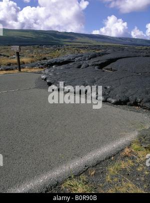 Hawaii Volcanoes national park Chain of Craters road Black lava flow on road Sign hawaii bigisland hawaiian islands - Stock Photo