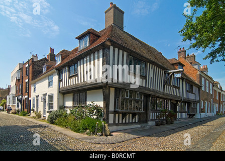 Horizontal wide angle of the beautiful Tudor cottages in Church Square in Rye on a sunny day. - Stock Photo