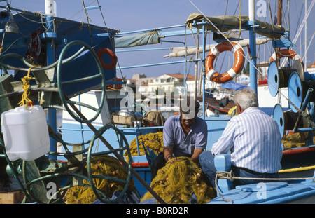 Fishermen in Pythagorion, Samos Island, Greece - Stock Photo