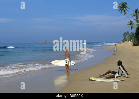 Surfer on Wewala Beach, Hikkaduwa, Sri Lanka - Stock Photo