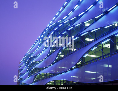 Exterior of multi-storey car park at night Cardiff Bay Cardiff South Wales UK - Stock Photo