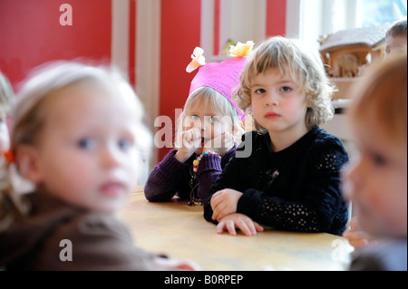 Holland Bussum daycare centre Koningskinderen a girl just turned four is celebrating her last day - Stock Photo