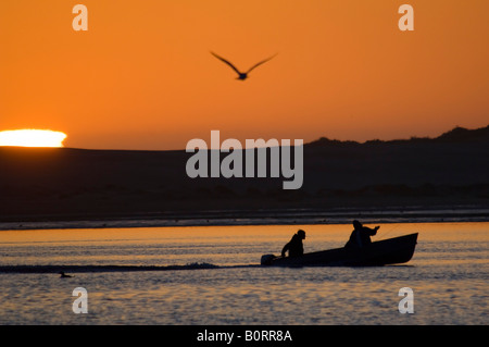 Boaters at sunset on the calm waters of Morro Bay California - Stock Photo