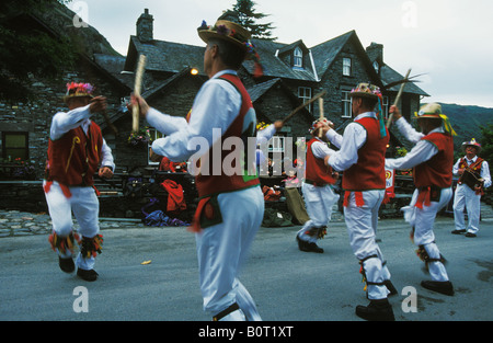 Morris dancers in front of Pub at Old Dungeon Ghyll in the Lake District England - Stock Photo