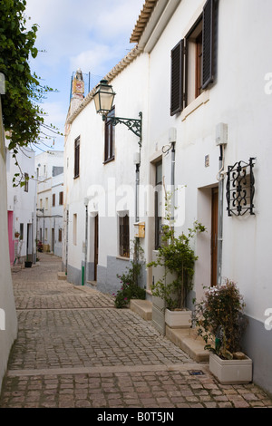 Back lane in Albufeira Algarve Portugal with traditional styled houses - Stock Photo
