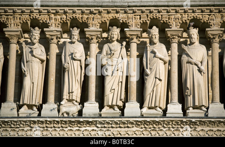 Statues on the West facade of Notre Dame Cathedral in Paris - Stock Photo