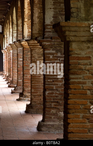 Brick pillars line a hallway at the Mission San Juan Capistrano in California. - Stock Photo
