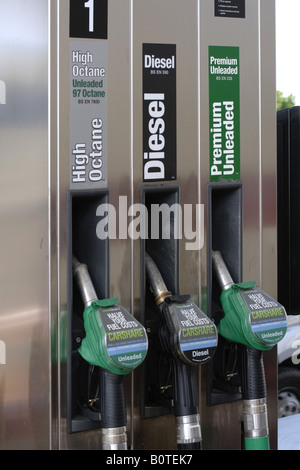 Three petrol pum nozzles at a filling station High octane Diesel and Premium Unleaded - Stock Photo
