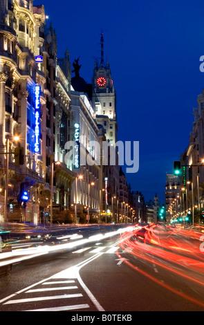 Gran Via in Madrid at dusk - Stock Photo