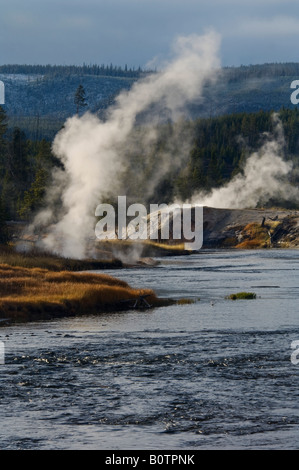 Geothermal vents and steam along the Firehole River Upper Geyser Basin Yellowstone National Park Wyoming - Stock Photo