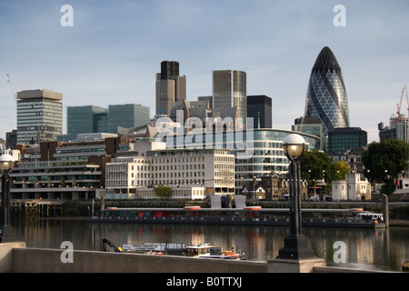 Early morning view of the City of London the financial district of London from the opposite bank of the River Thames - Stock Photo
