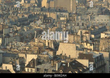 Rooftops in evening light Paris France - Stock Photo