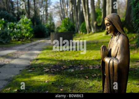 Statue at Ohlsdorf Cemetery in Hamburg, Germany - Stock Photo