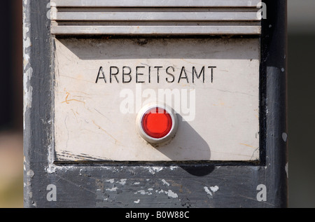 Red doorbell button, 'Arbeitsamt' (employment agency) in writing - Stock Photo