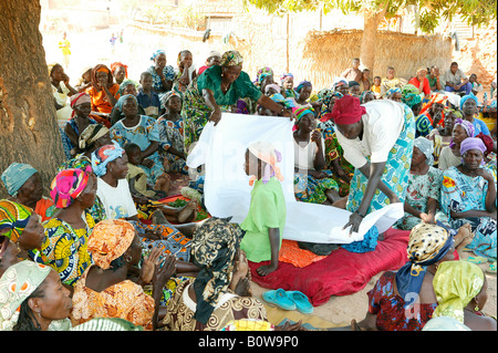 Funeral of a woman who died of HIV/AIDS, body wrapped in sheets, Garoua, Cameroon, Africa - Stock Photo