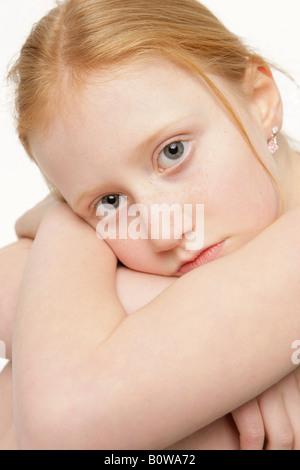 8-year-old girl, sad - Stock Photo