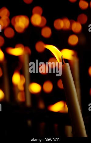 Votive candles in a side chapel of Rocio Church, El Rocio, Andalusia, Spain - Stock Photo