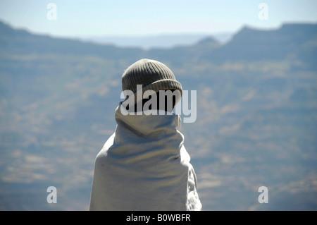Ethiopian orthodox follower dressed in a white cape, Asheton Maryam Monastery, Lalibela, Ethiopia, Africa - Stock Photo