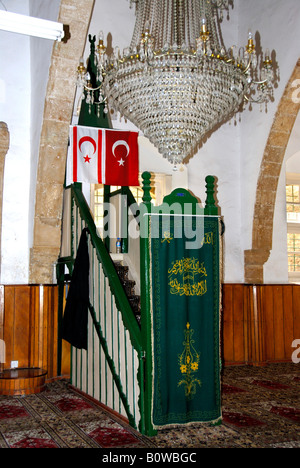 Flags of North Cyprus and Turkey hanging in the Aga Cafer Pascha Mosque, Girne or Kyrenia, North Cyprus - Stock Photo