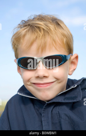 Five-year-old boy wearing sunglasses - Stock Photo