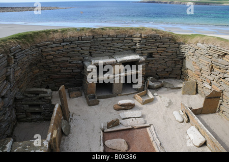 Skara Brae on mainland Orkney is a 5,000-year-old settlement next to the Bay of Skaill. - Stock Photo