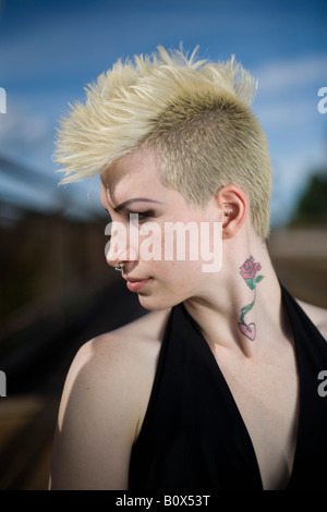 Profile of a young woman with a mohawk - Stock Photo