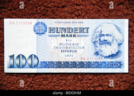 'Former East Berlin' Germany Front of 'Bank Note' '100 East German' 'D.D.R' Marks with Illustration of 'Karl Marx' - Stock Photo