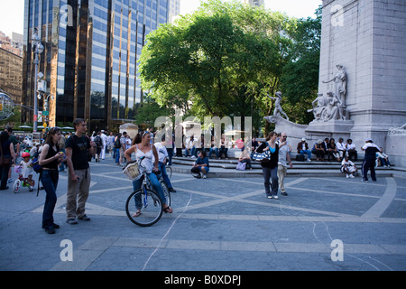 People at entrance to Central Park near Columbus Circle New York City - Stock Photo