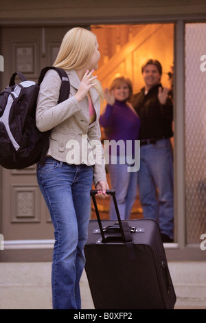 Surprising Mother And Daughter Waving Goodbye To Father Stock Photo 74787766 Alamy Door Handles Collection Olytizonderlifede