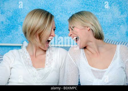 Two blonde women fooling about, portrait - Stock Photo