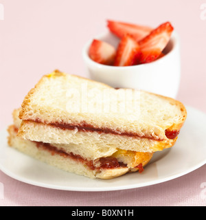 Toast with strawberry jam - Stock Photo