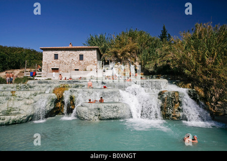 Italy, Tuscany, Saturnia, Group of people enjoying in a hot spring - Stock Photo