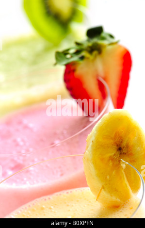 Assorted fruit and berry smoothies close up - Stock Photo