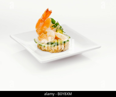 Sandwich with shrimps and cucumber slices - Stock Photo