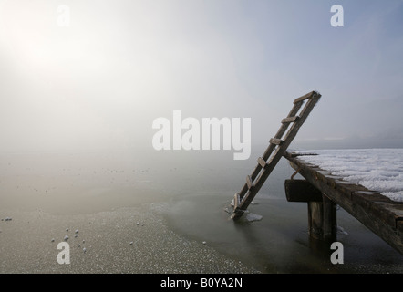Germany, Bavaria, Murnau, Wooden jetty on lake - Stock Photo
