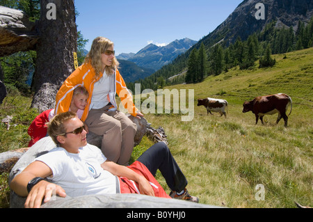 Austria, Salzburger Land, couple with daughter taking a break - Stock Photo