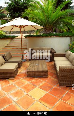 Patio of mediterranean villa in French Riviera with wicker furniture - Stock Photo