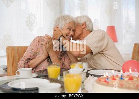 Senior couple embracing, smiling - Stock Photo