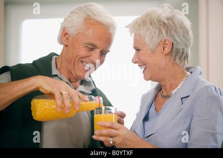 Senior couple, senior woman holding glass - Stock Photo